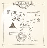 Doodle Cannons. Hand drawn cannons and related objects like sponge and cannonballs. EPS8 Stock Photo