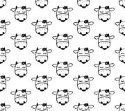 Doodle cartoon seamless pattern with cows. Stock Image