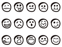 Doodle cartoon smiley faces Stock Images