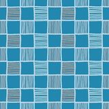 Doodle checkered seamless vector pattern in blue and orange vector illustration