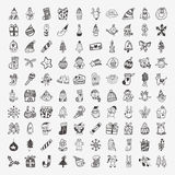 100 Doodle Christmas icon set. Cartoon vector illustration Royalty Free Stock Photography