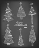 Doodle Christmas trees Stock Images