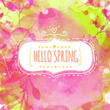 Doodle decorative frame with text hello spring. Nature inspired pink and green background with watercolor texture and leaves. Vect Stock Photo