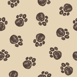 Doodle dog tracks seamless pattern background. Stock Photos
