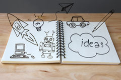 Doodle drawing idea on paper book Royalty Free Stock Photos