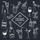Doodle and drinks. Drinks doodle set. Hand drawn cocktails icons on chalkboard. Doodle beverages collection. Bottles, glass, cocktails. Water, wine and juice Royalty Free Stock Images