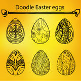The doodle Easter eggs on the yellow background, vector Royalty Free Stock Images