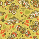 Doodle floral seamless background. Cute pattern with butterflies and fly hearts Stock Images