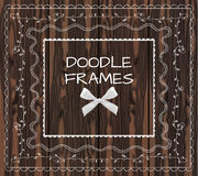 Doodle frames: VECTOR set with realistic bow on wood . Doodle frames: VECTOR set with realistic bow on brown wood background Stock Illustration