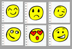 Doodle hand drawn smiles on notebook page. Colored Stock Photos