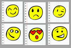 Doodle smiles on notebook page. VECTOR. Coloured yellow smiles Royalty Free Stock Images