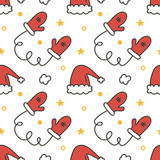 Doodle, hand drawn winter christmas seamless pattern background with mittens and santa hats Royalty Free Stock Image