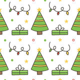 Doodle, hand drawn winter seamless pattern background with christmas trees and gift boxes Royalty Free Stock Image