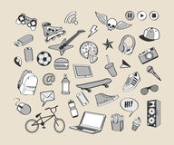 Doodle icon set. Monochrome hand drawn collection of doodle elements for design. Set for boy or teenager. Sport, food, music, multimedia Stock Images