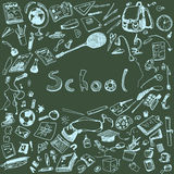 Doodle illustration of school objects. Blue chalk outlined illustration of design elements, blackboard background. Royalty Free Stock Photography