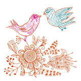 Doodle love birds in floral environment. Cute doodle flowers and two love birds - ethnic style Royalty Free Stock Photography