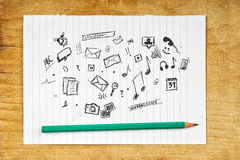 Doodle Multimedia Icons on Paper Royalty Free Stock Photo