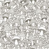 Doodle mushrooms seamless pattern. Black and white background Stock Images