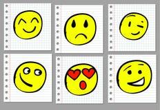 Doodle ręka rysująca ono uśmiecha się na notatnik stronie barwiony Zdjęcia Stock