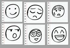 Doodle ręka rysująca ono uśmiecha się na notatnik stronie czerń Zdjęcia Stock
