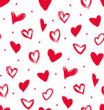 Doodle red hearts in a seamless pattern. Stock Images