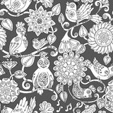 Doodle seamless background with steampunk birds and flowers. royalty free illustration