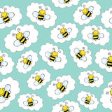 Doodle seamless pattern with bees. Vector format royalty free illustration