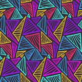 Seamless pattern with colorful scratched triangles. Doodle seamless pattern with bright neon color scratched triangles on dark background. Abstract fashion stock illustration