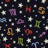Doodle seamless pattern with bright zodiac signs on dark backgro Royalty Free Stock Photography