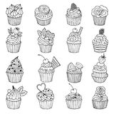 Doodle set of cupcakes. Hand drawn vector illustrations isolate on white Royalty Free Stock Image