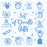 Doodle set of presents, ribbons, stars. Vector isolated on paper for celebration design. Royalty Free Stock Images