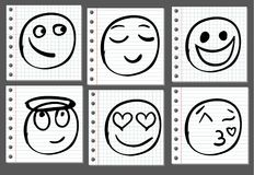 Doodle sketched smiles on notebook page. VECTOR. Black lines. Royalty Free Stock Images