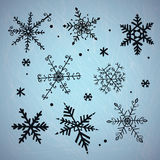 Doodle snowflakes. Vector background. Stock Images