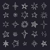 Doodle stars on black background. Cute pen sketch space elements, simple geometric set. Vector hand drawn star pattern royalty free stock images
