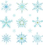 Doodle stylowi wektorowi płatek śniegu ustawiający royalty ilustracja