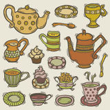 Doodle tea set. Illustration of hand drawn tea set with tea cups, teapots, sugar bowl, milk jug, plates, cupcakes and spoons Royalty Free Stock Images