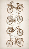 Doodle vintage bicycle set. Vector hand drawn stylish city bicycle set on paper background. Editable isolated objects Stock Images