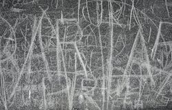 Doodle writing on facade. Abstract doodle writing on old gray facade royalty free stock photo