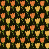 Doodle yellow tulip pattern. Cute seamless background. Stock Photos