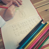 Doodles ребенка в тетради школы Стоковые Фото