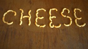 Doodles сыра на таблице коричневого дуба Стоковые Изображения