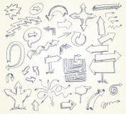 Doodles da seta. Desenhado mão Foto de Stock