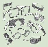 Doodles de los vidrios exhaustos de la mano Foto de archivo libre de regalías