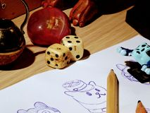 Doodles and dice. Art supplies. stock image
