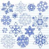 Doodles imprecisi disegnati a mano dei fiocchi di neve di inverno Immagini Stock