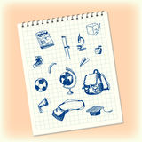 Doodles in a notebook. Hand drawn school objects. Schoolbag, apple, banana, globe, square academic cap, microscope, ball royalty free illustration