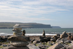 Doolin beach rock stacks. Rock piles on the beach in doolin county clare ireland stock image