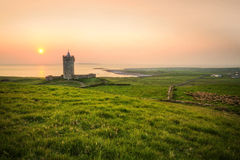 Doolin castle at sunset. Doonagore castle at sunset - Ireland Royalty Free Stock Image
