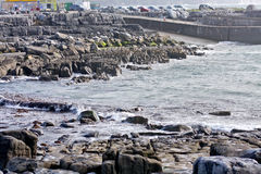 Doolin Pier, county Clare, Ireland. Windy day at Doolin`s Bay, The Burren, County Clare, Ireland Stock Photo