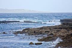 Waves crashing at Doolin beach, county Clare, Ireland. Doolin`s Bay, The Burren, County Clare, Ireland Stock Photos